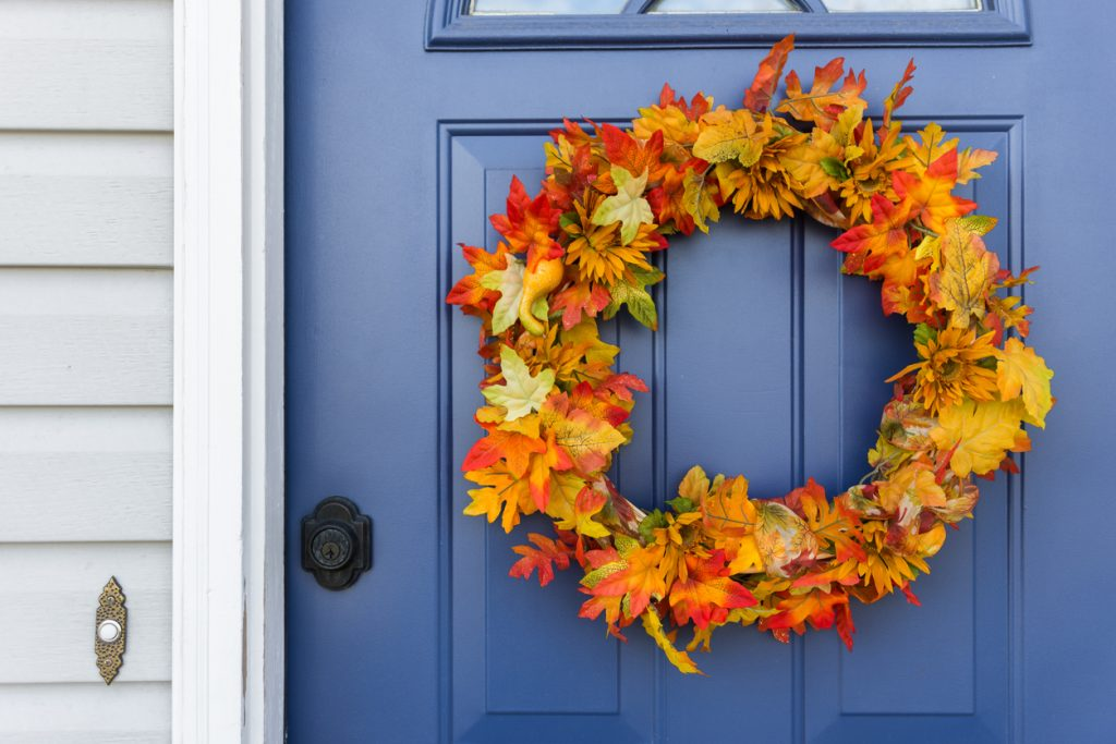 Closeup of exterior door with decorative autumn wreath